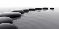 black, smooth stones in water