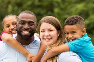 Smiling interracial family of four