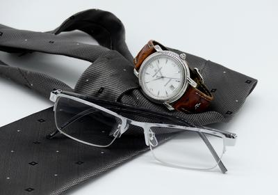 Glasses, watch and tie
