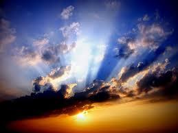 sun shining through clouds