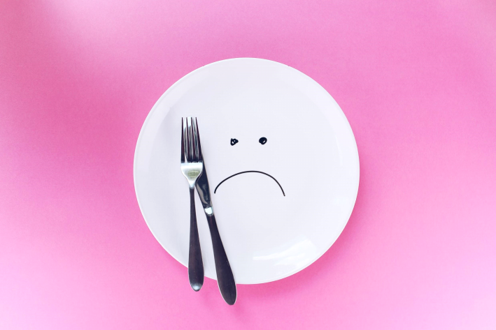 Plate with a frowning face