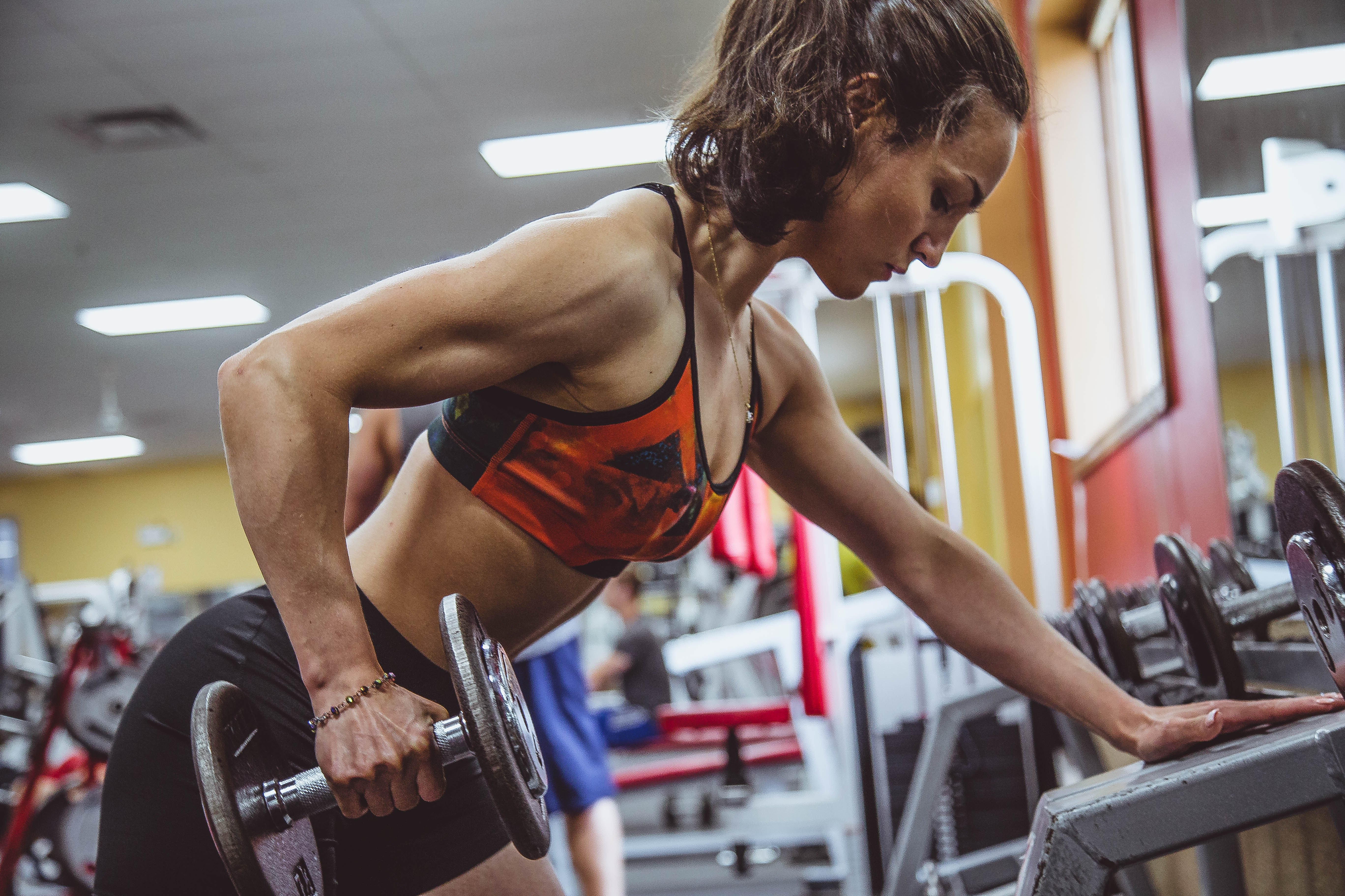 Woman lifting weights in a gym