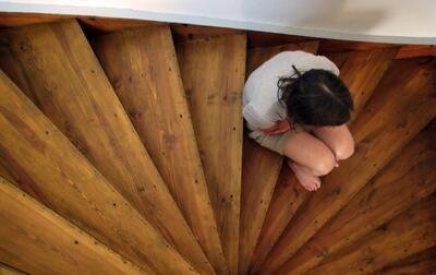 person sitting on stairs
